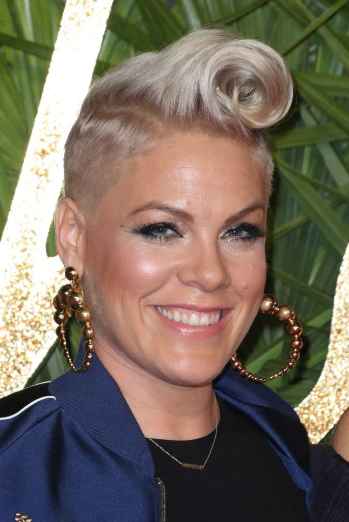 PInk with a a quiff mohawk hairstyle - androgynous haircut