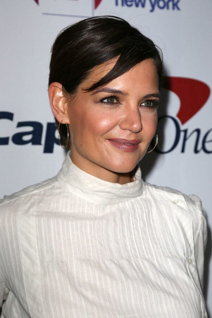 Katie Holmes with dark hair swept to one side - androgynous haircuts