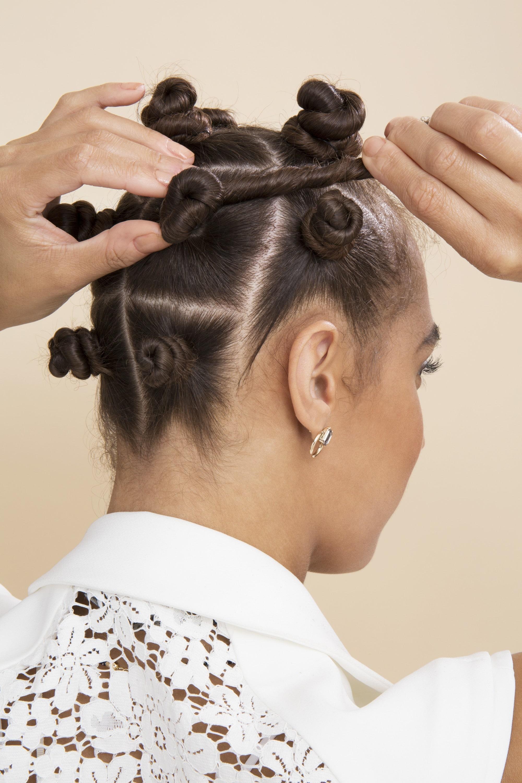 Bantu knots - model twisting final bantu knot at back of head