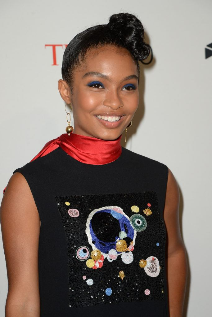 Iranian-American actress, model, and activist Yara Shahidi at the time 100 gala with her natural hair in a twisted side set updo