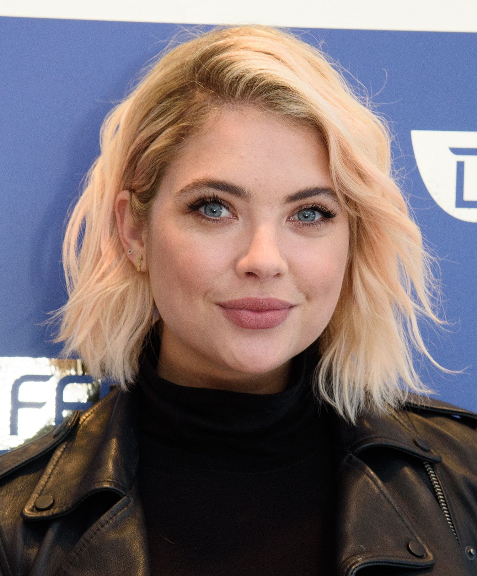 hairstyles for a round face: ashley benson with wavy chin length bob