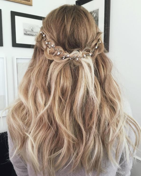 Braided half,up-half,down wavy hairstyle with hair accessory