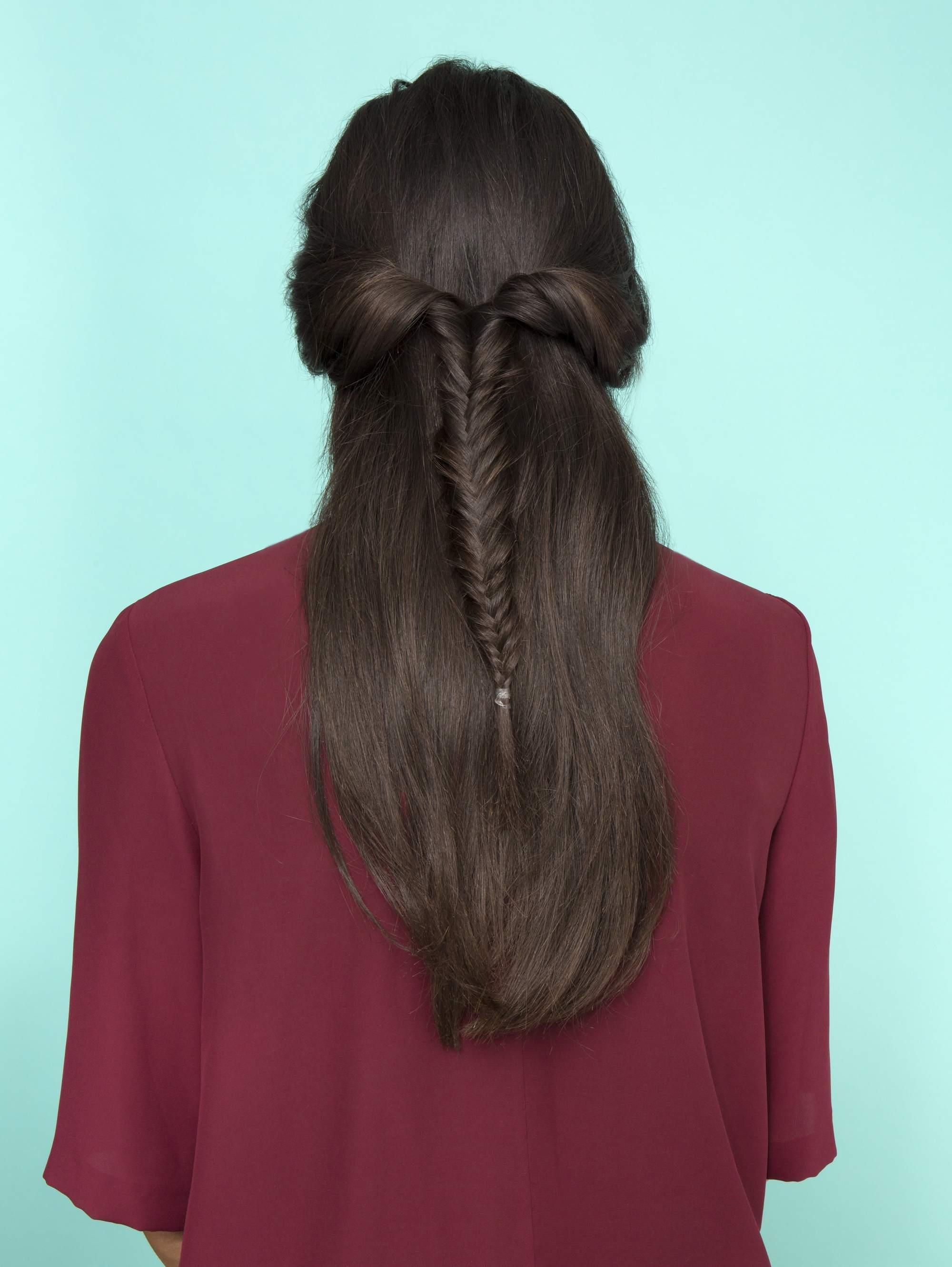 Long dark brown hair with half,up fishtail braid