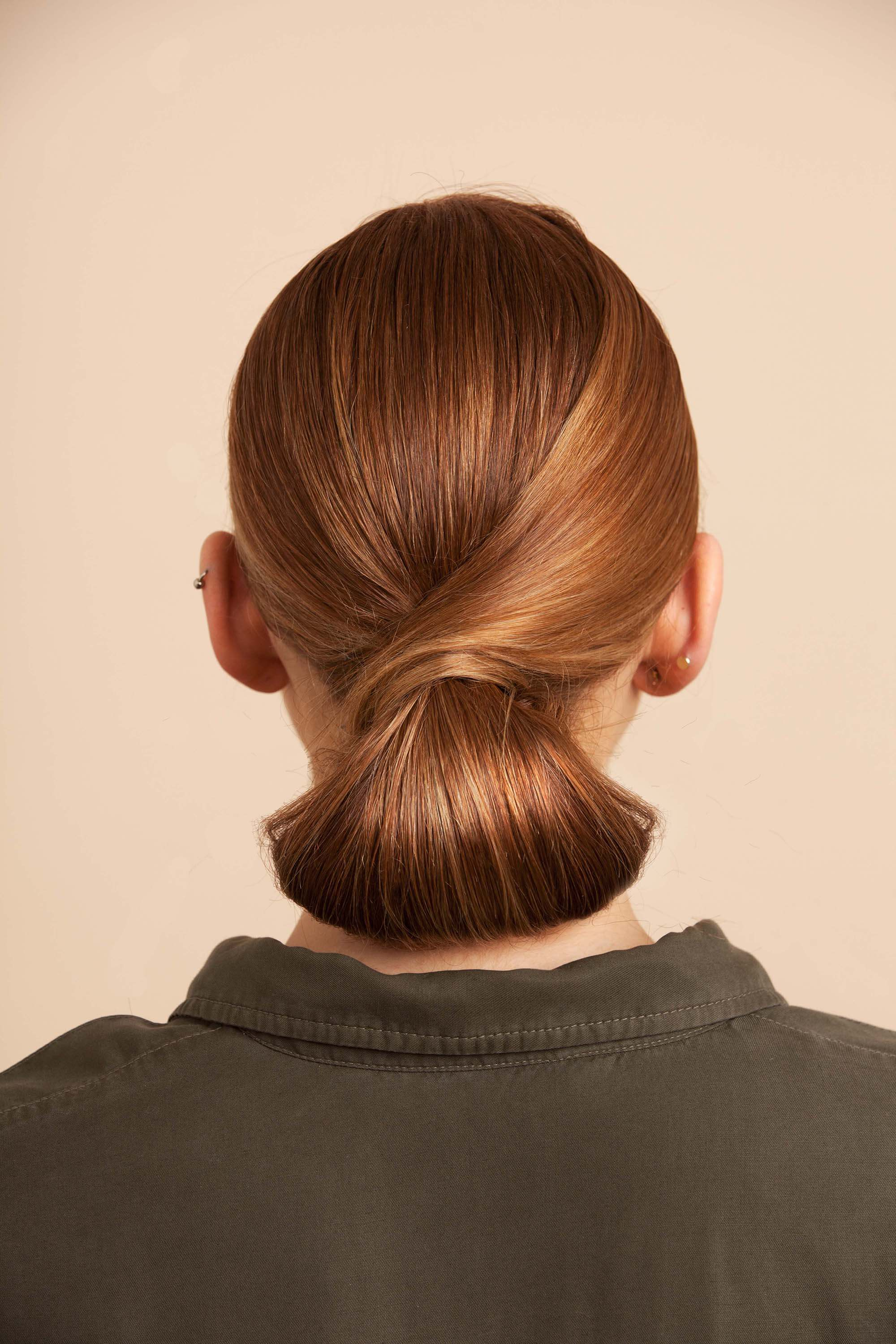 Tucked hairstyle on medium toned brown hair