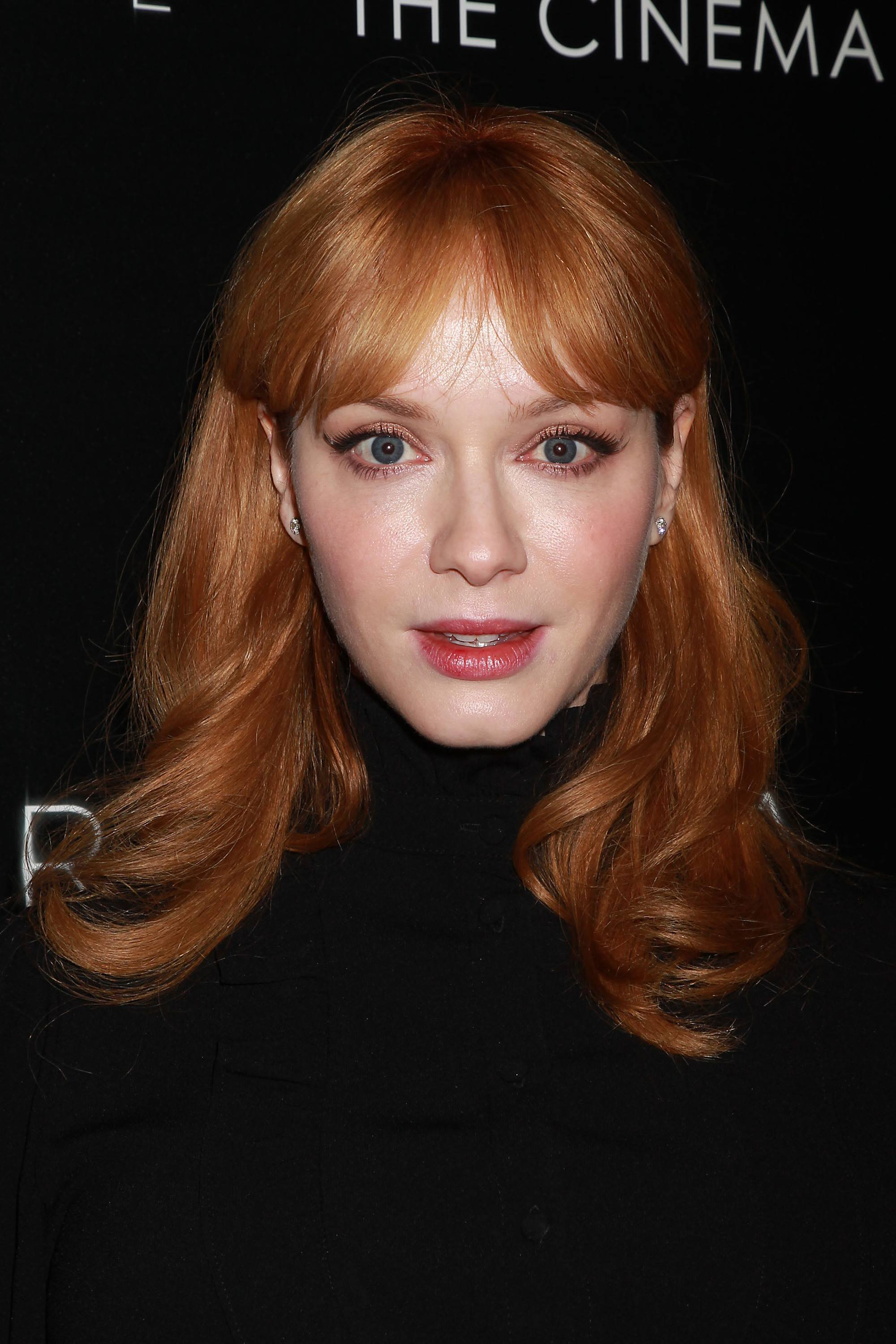 christina hendricks with curly red hair with a split fringe