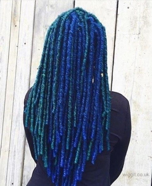 woman with long blue and teal dreadlocks