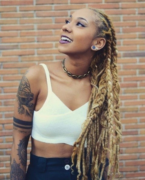 woman with blonde cornrow dreadlocks