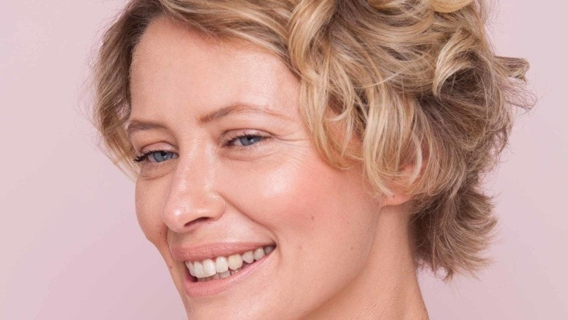model with short beach hair look smilling