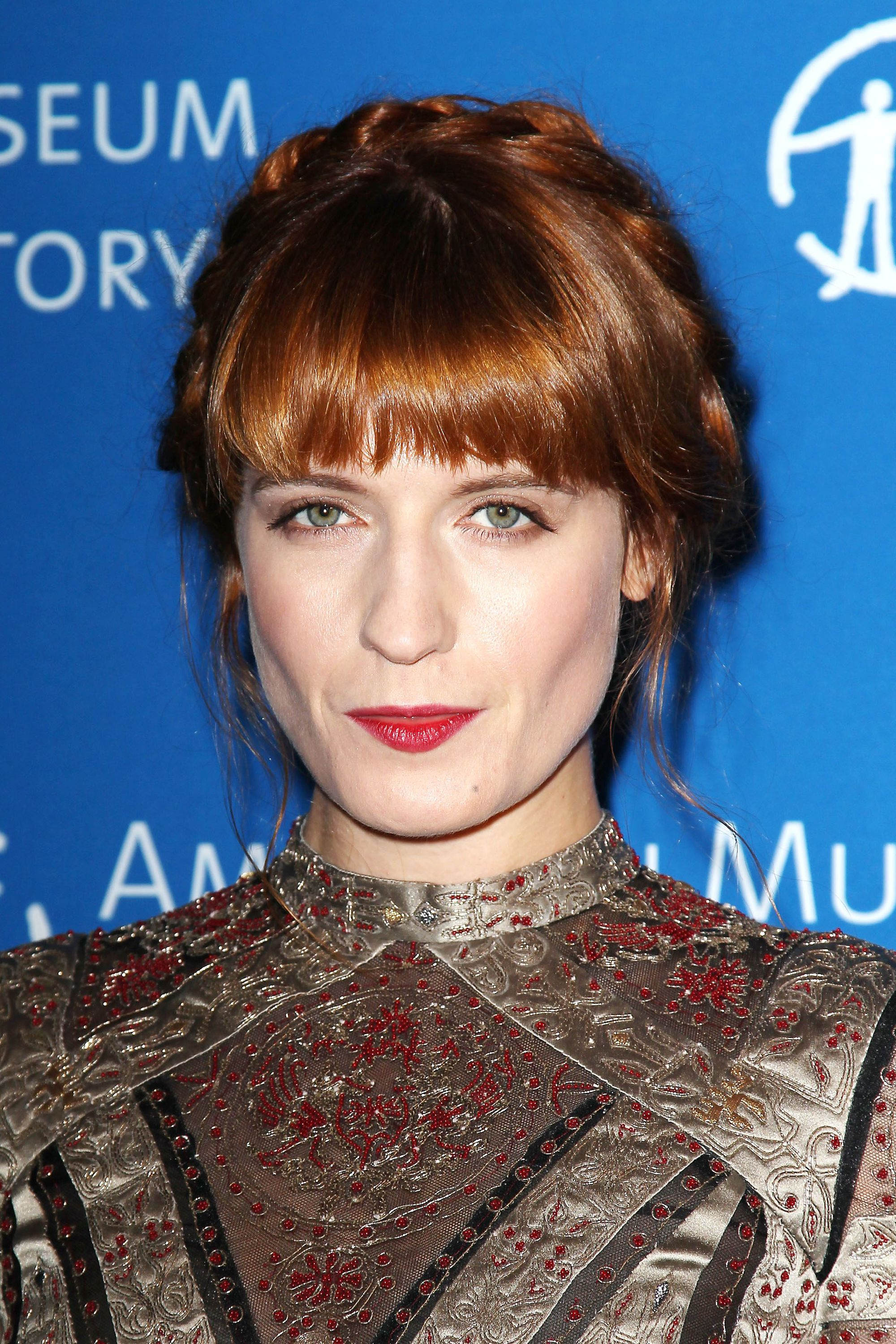 singer florence welch with her auburn hair in a pretty halo braid