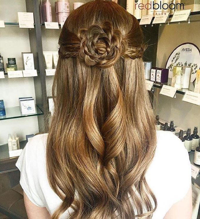 Long wavy brown hair with floral braid design
