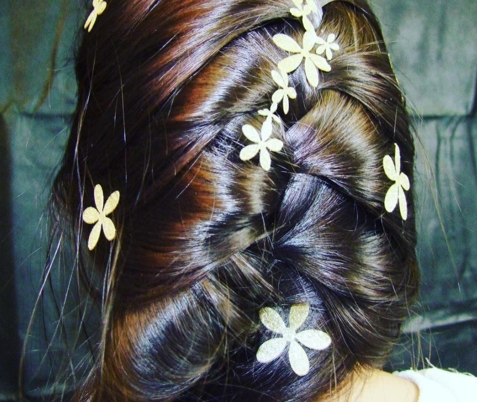 floral hair stickers on a french braid hairstyle
