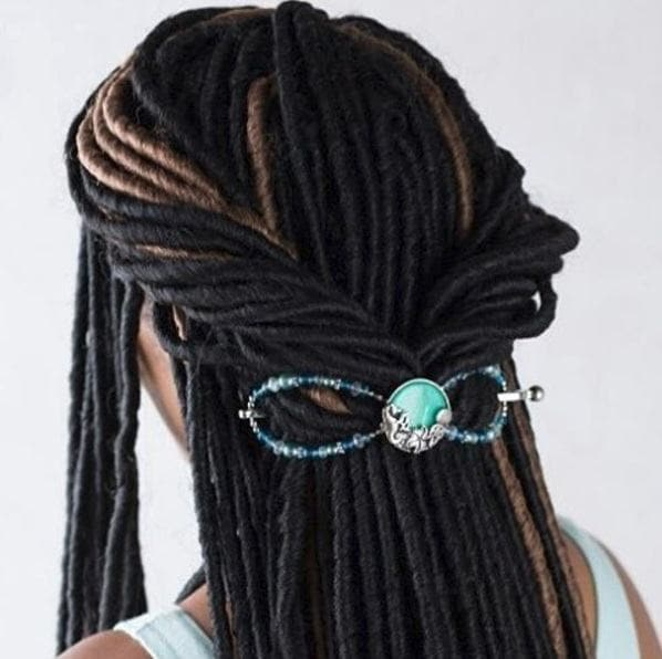 woman with dreadlocks in a twisted half-up style