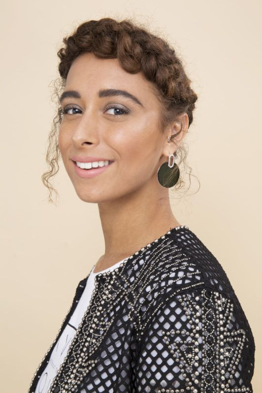 woman with natural curly hair in a halo braid