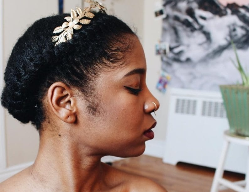 halo braid african american hair: model with natural halo braid hair with gold accessory