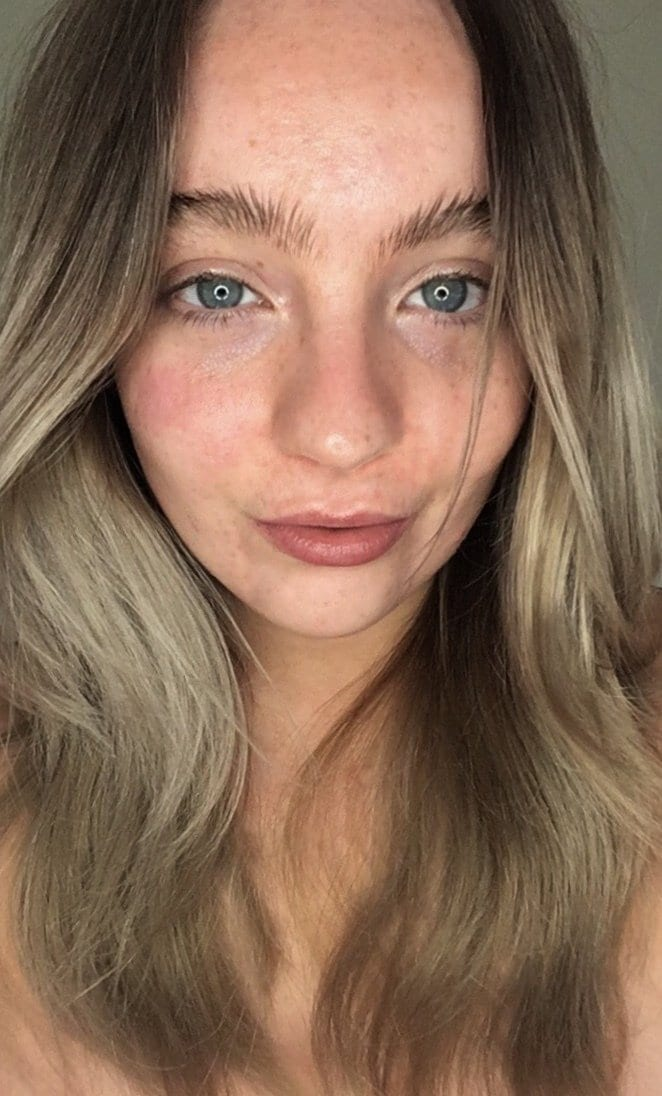Elle from Bambi Does Beauty with long ash blonde hair in loose waves