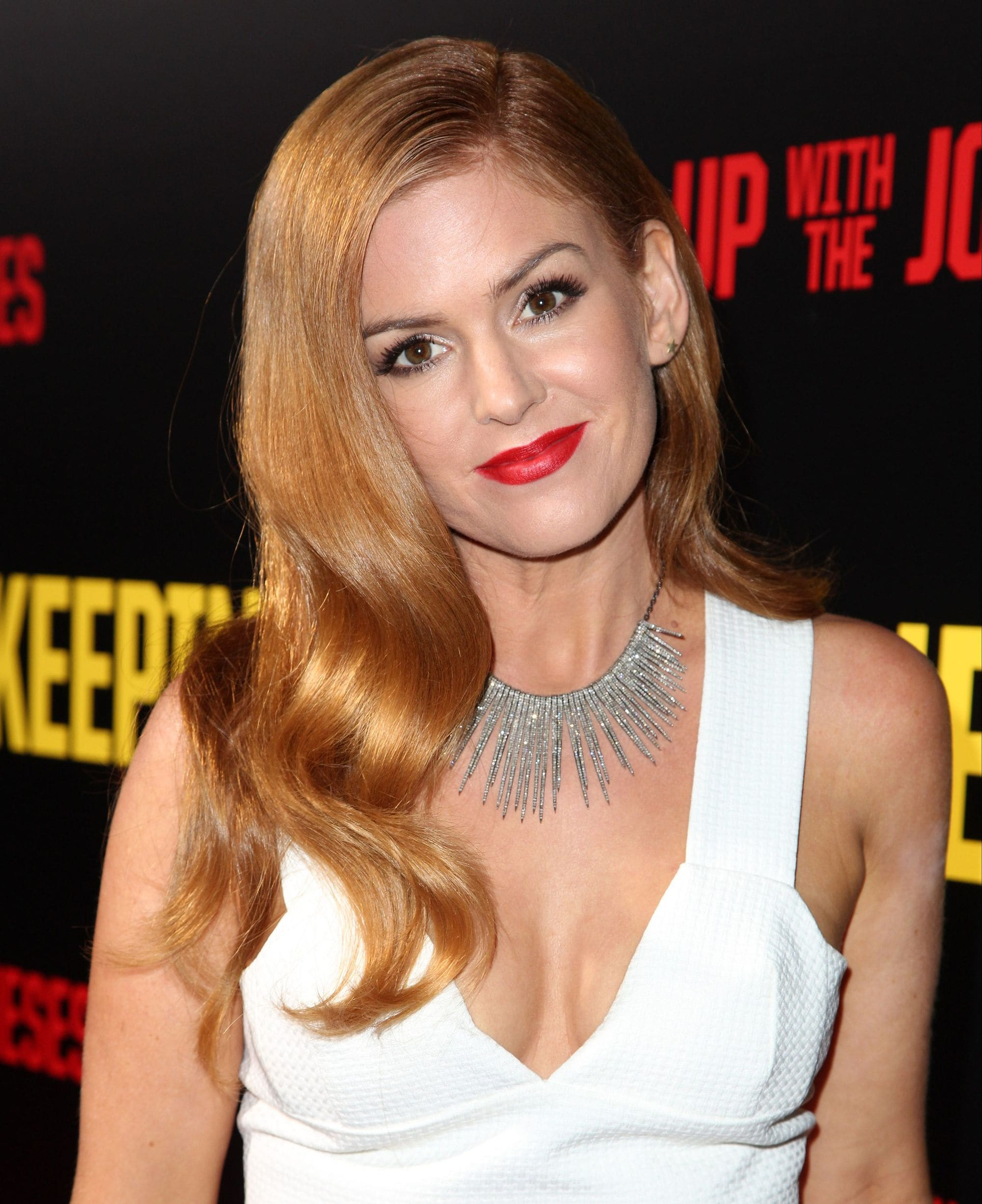 isla fisher on the red carpet with her red hair in hollywood waves
