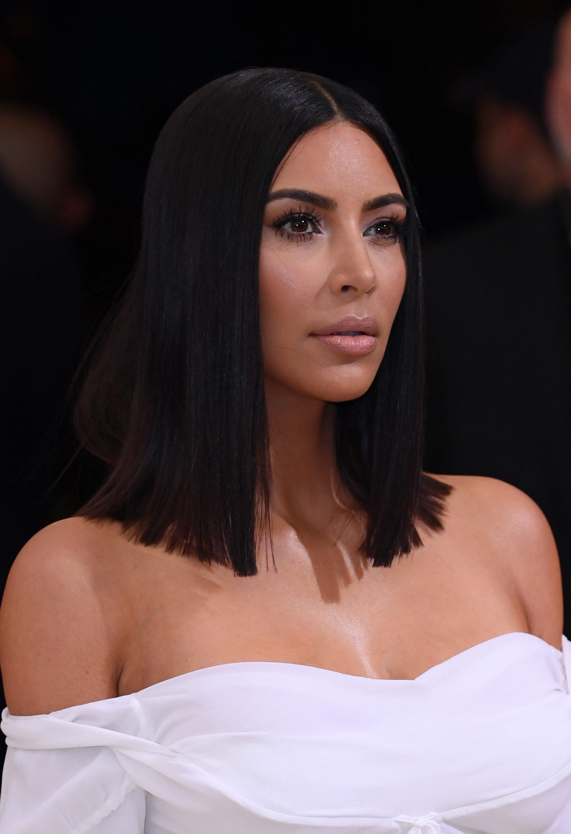 met gala hair: kim kardashian west with sleek lob hairstyle and white dress at met gala