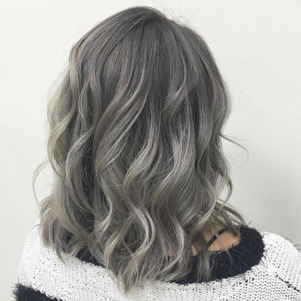 woman with wavy silver lob length hair