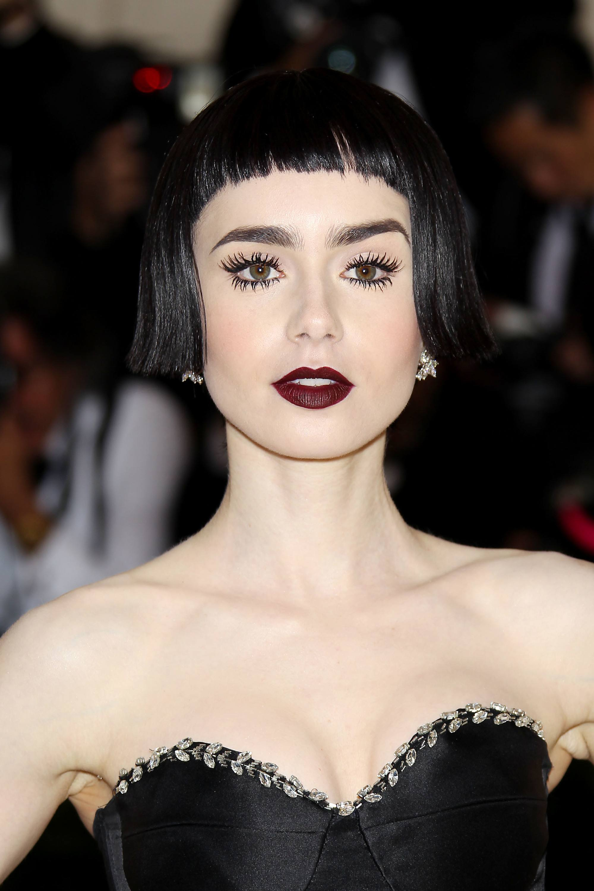 met gala hair: lily collins with betty boop inspired hair cut and black dress at met gala