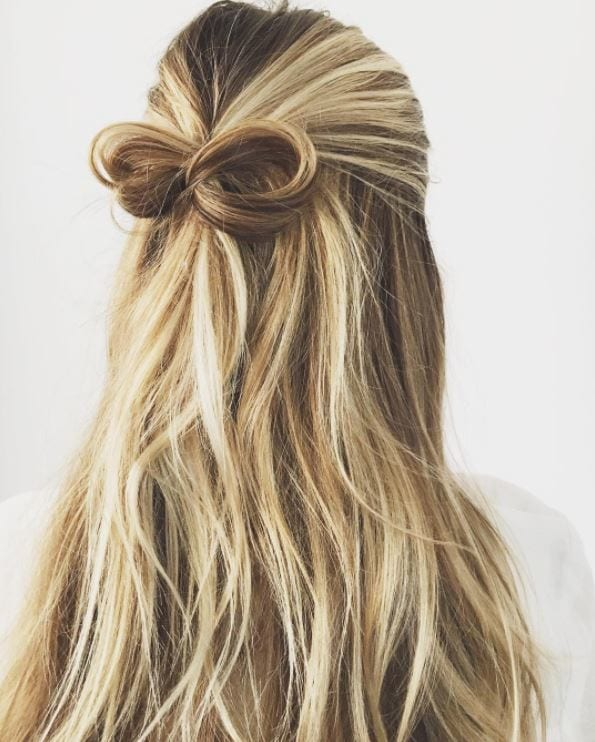 Long blonde wavy hair in bow half,up-half,down hairstyle