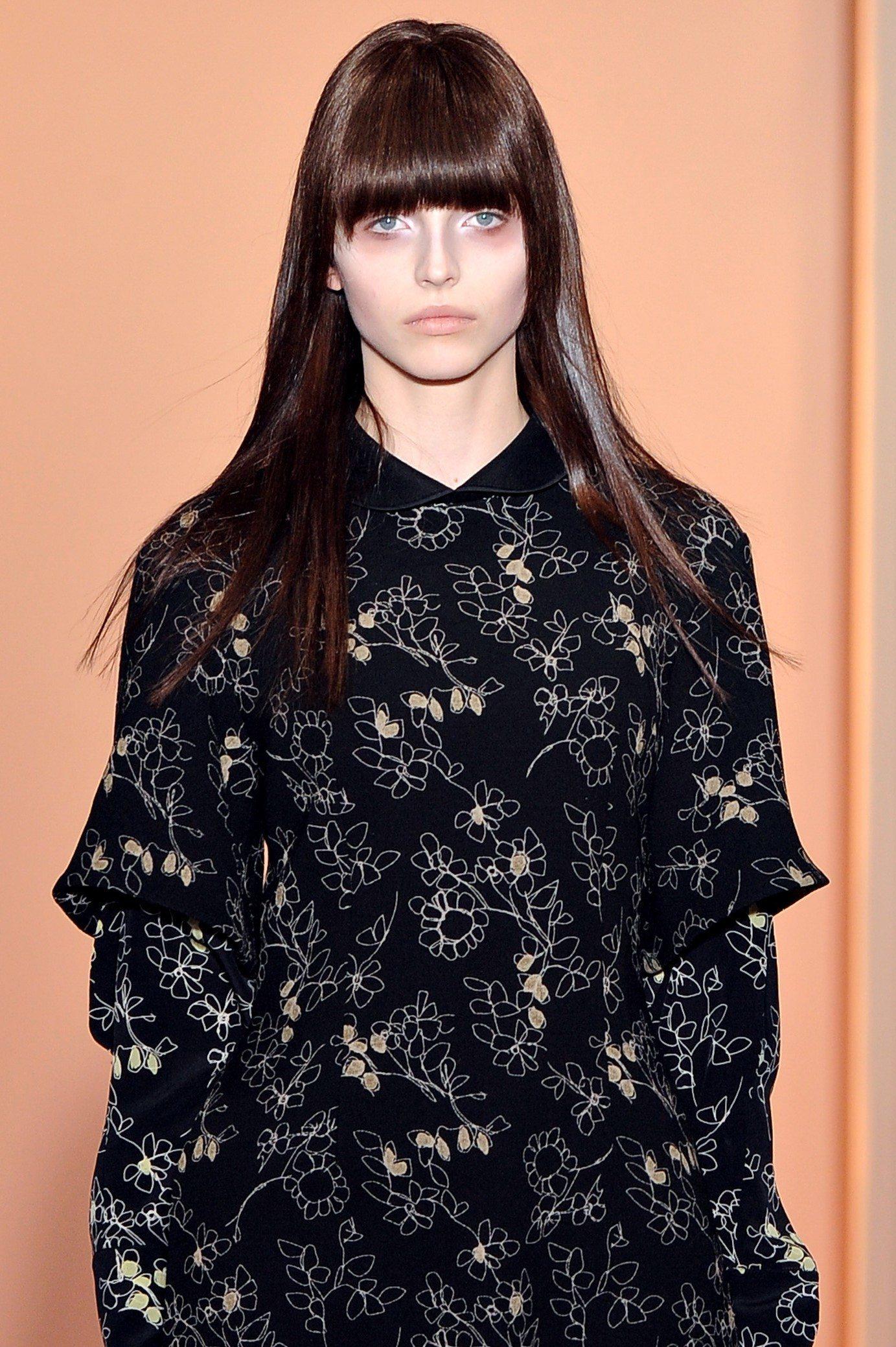 brunette marni model with a blunt full fringe