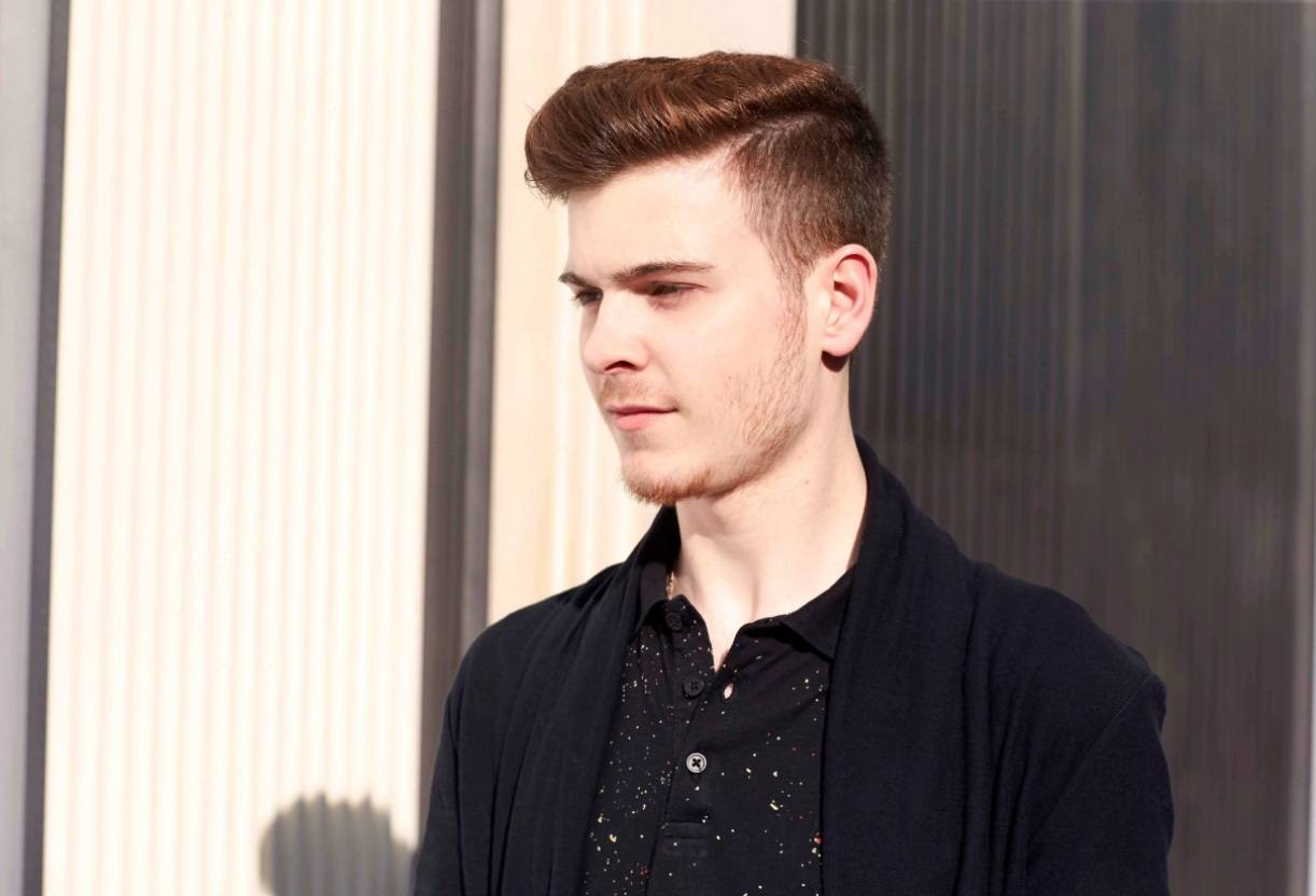 red haired male model with a modern pompadour quiff hairstyle