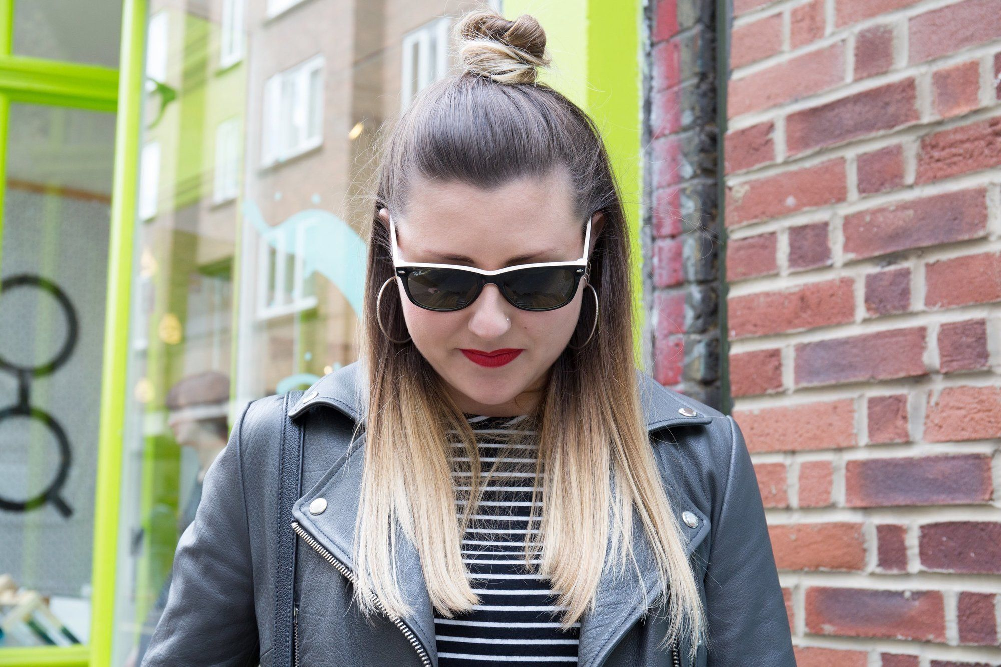 Front view of a woman with ombre hair, red lipstick and sunglasses