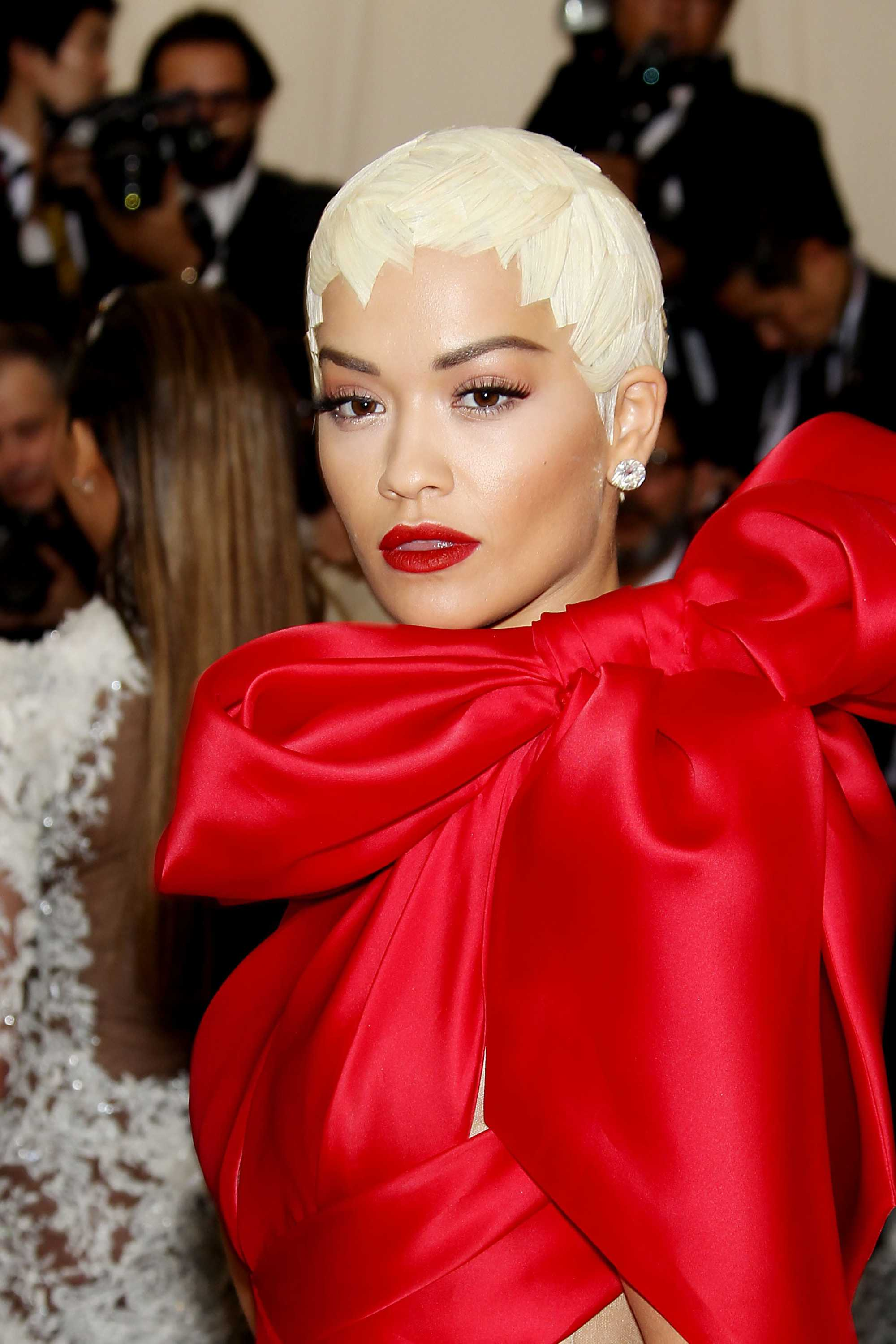 rita ora with quirky short hairstyle with red bow dress at the met gala event