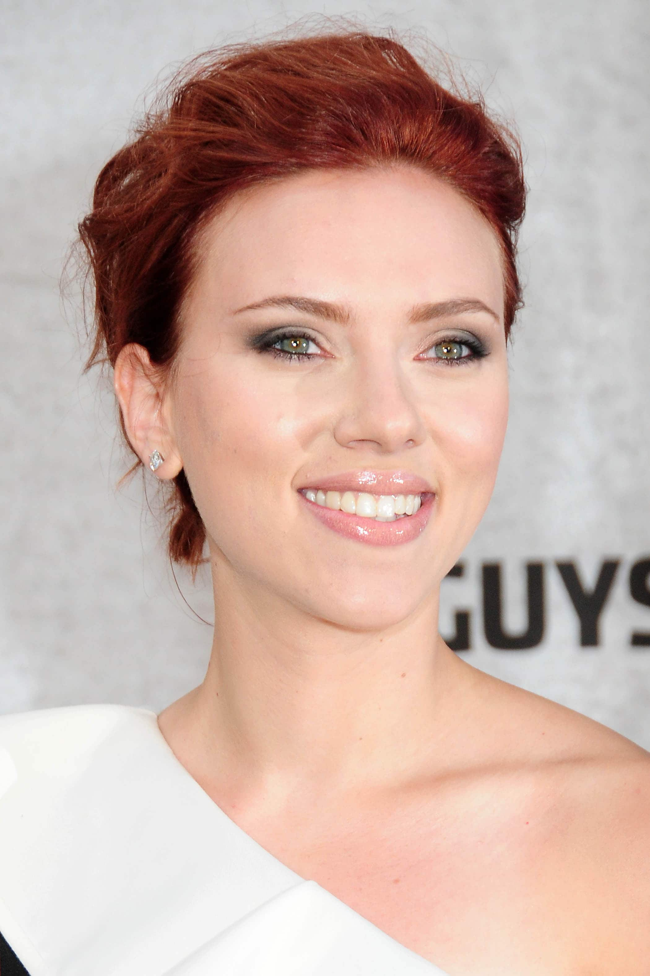 scarlett johansson on the red carpet with short auburn hair in an updo