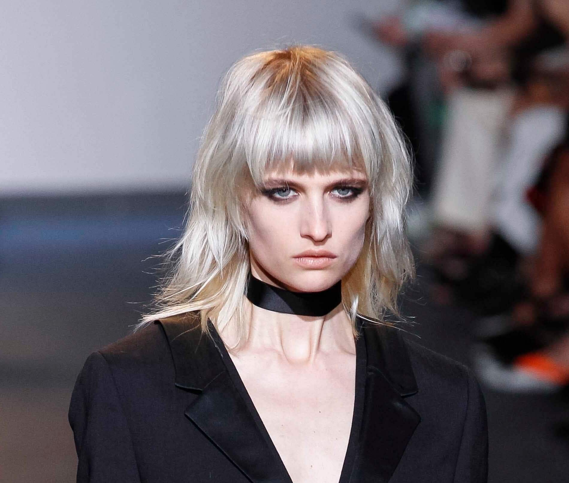 model on the catwalk with silver medium length hair with bangs