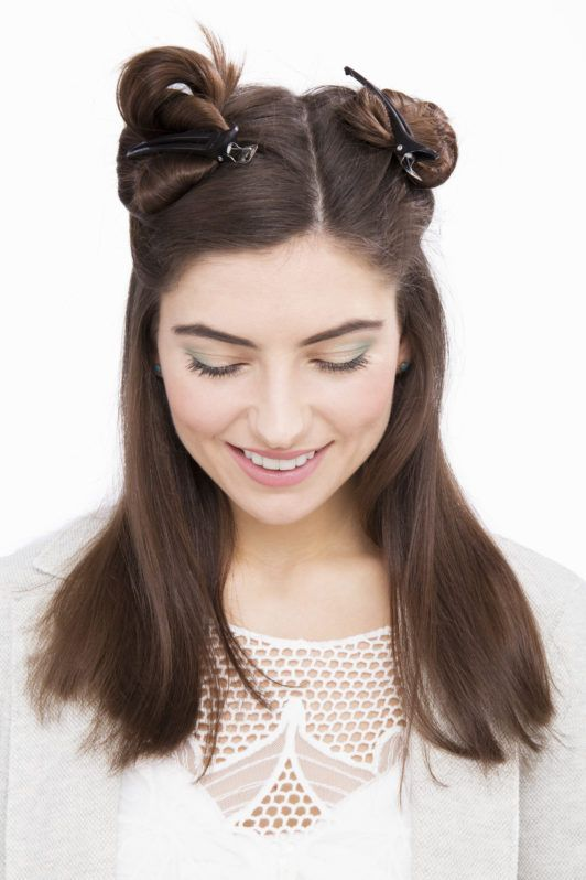 brunette model with hair clipped up