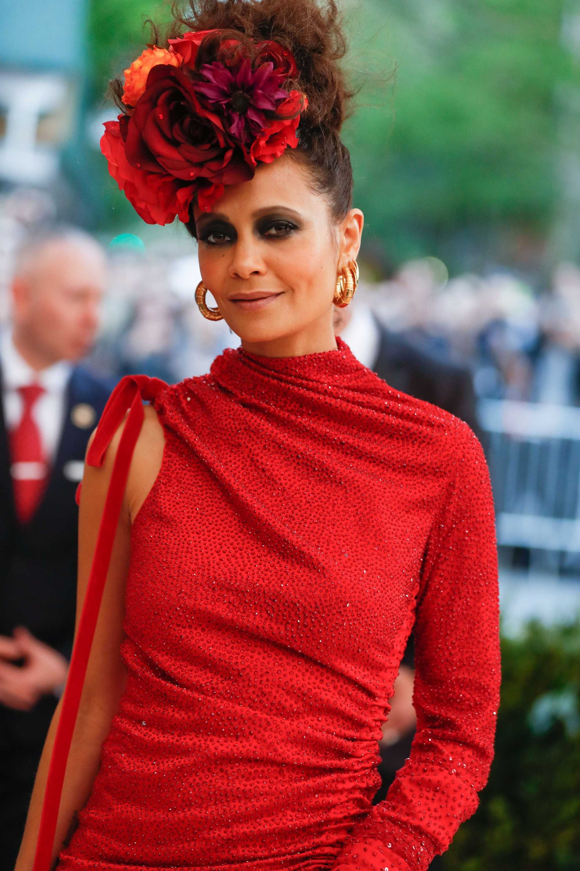 thandie newton with floral updo and red dress at the met gala