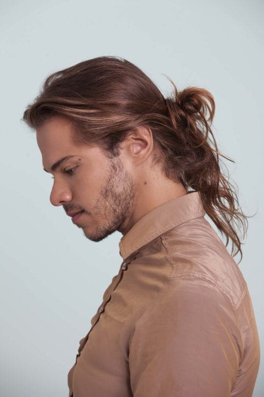 Man bun tutorial guy with messy man bun looking down side profile picture