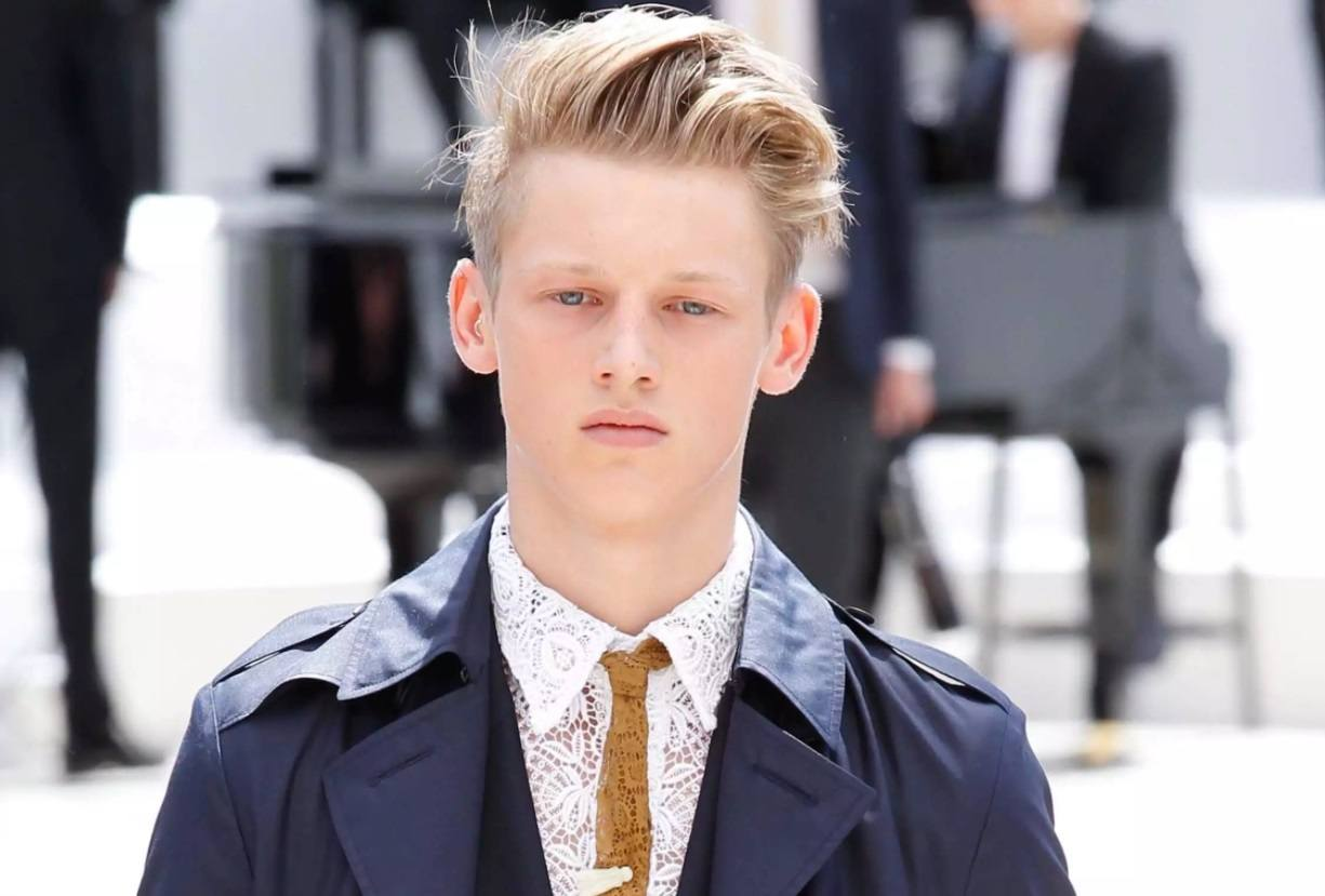 male model with a blonde undercut quiff hairstyle
