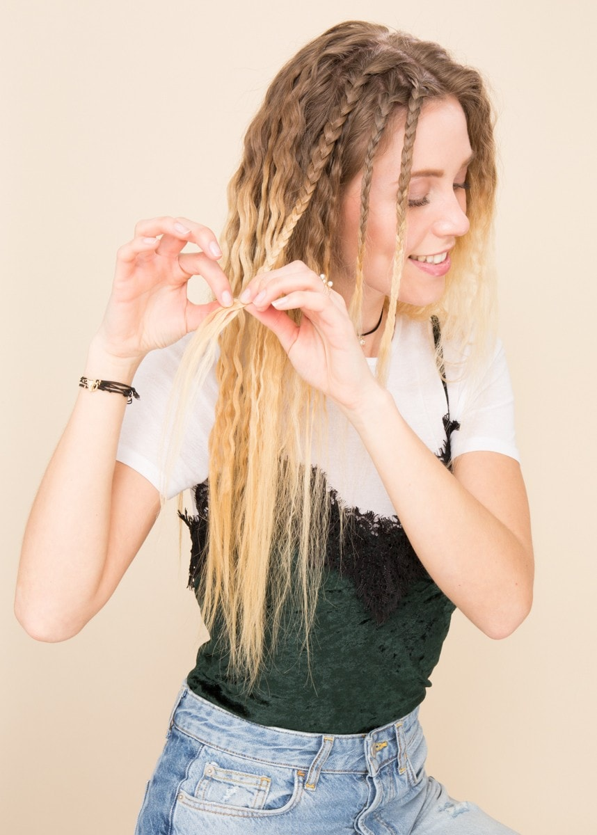 girl with ombre brunette to blonde hair unravelling braids