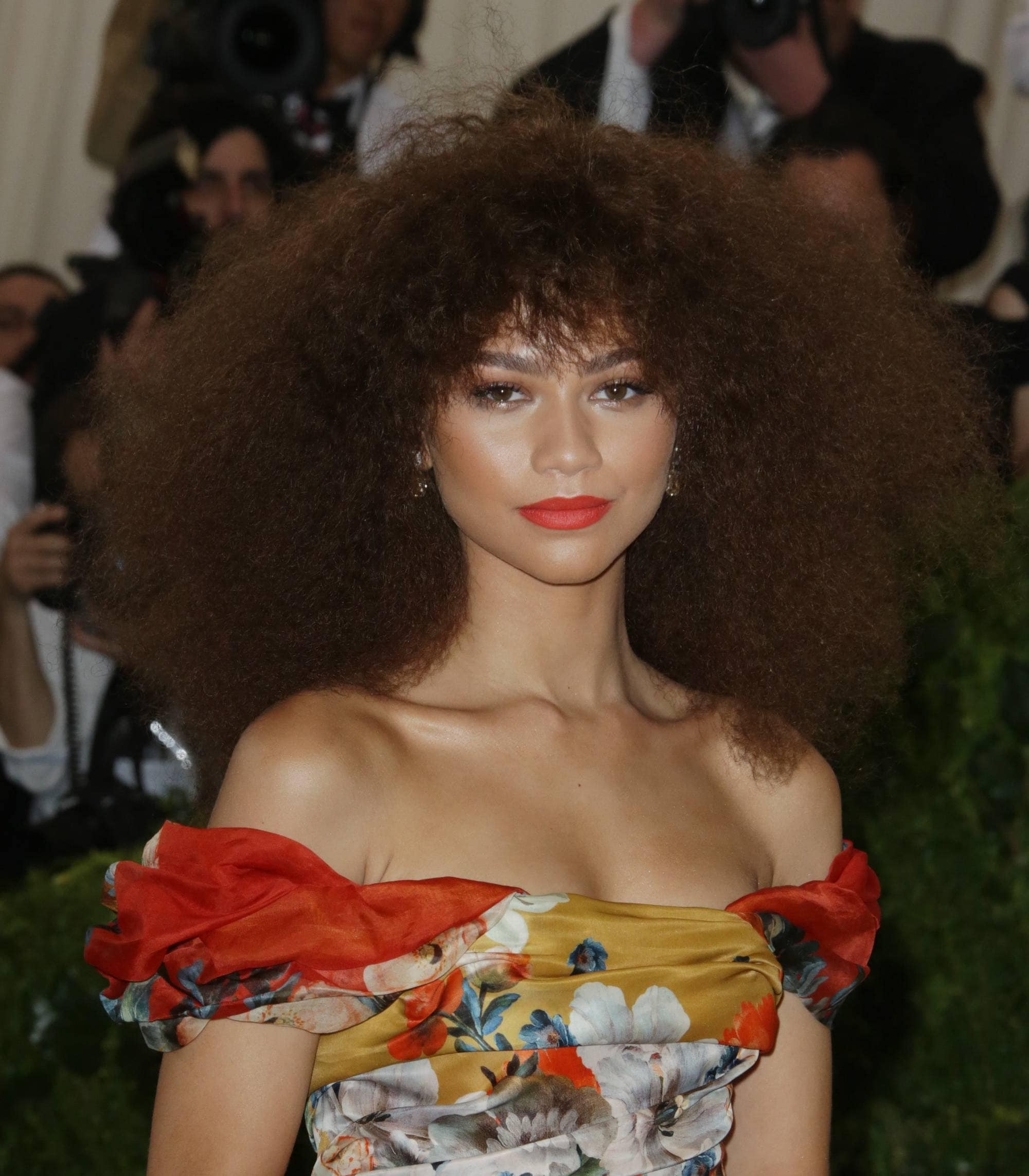 zendaya with curly afro hair and bangs on the met gala red carpet