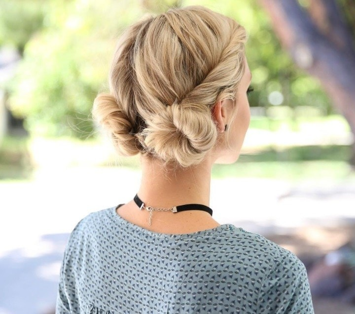backshot of woman with blonde hair twisted into two low buns