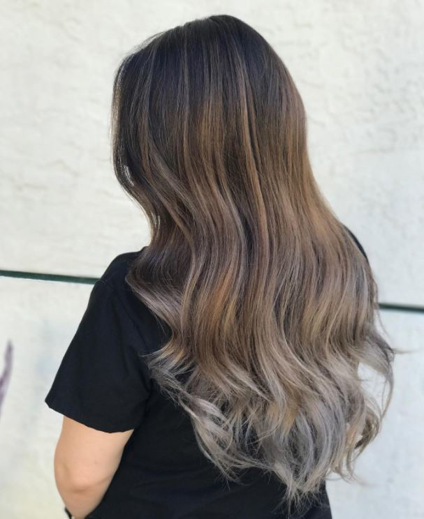Ash brown balayage hair with grey toned balayage finish