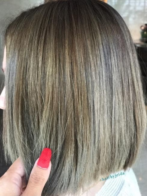 Ash brown hair with highlights - bob length - side view