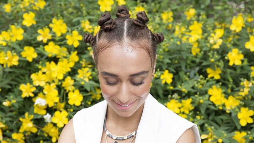 Bantu knots - model with brown hair with bantu knots all over as final look of tutorial