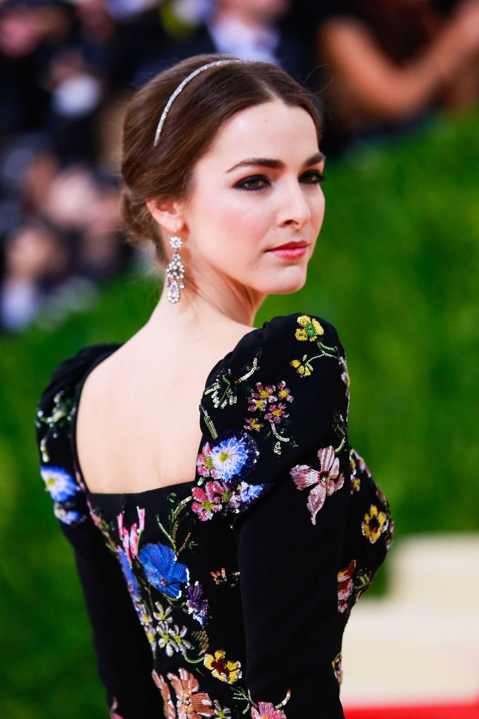 Headband and bandana hairstyles: Bee Shaffer on the red carpet at MET Gala with her brown her styled in a chic updo with minimal headband.