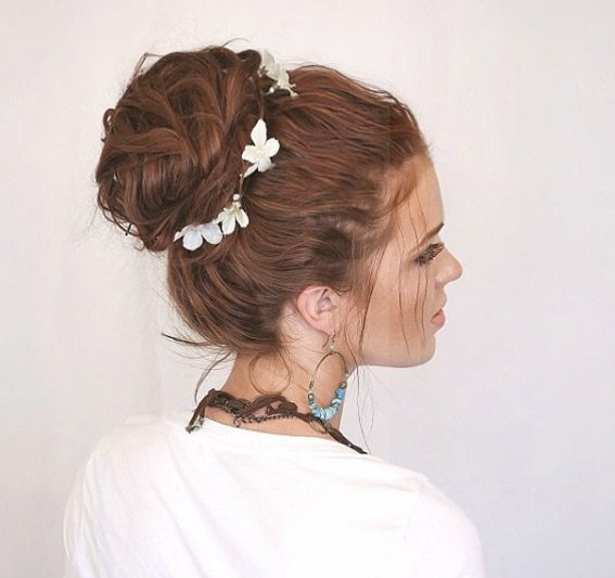 hairstyles for greasy hair: woman with bouffant bun hairstyle