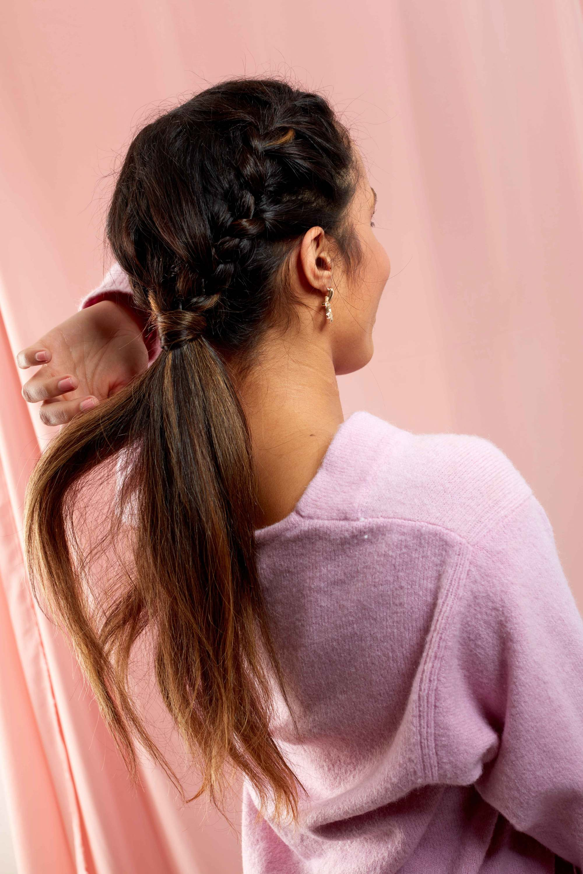 Brunette woman with long hair in a braided ponytail