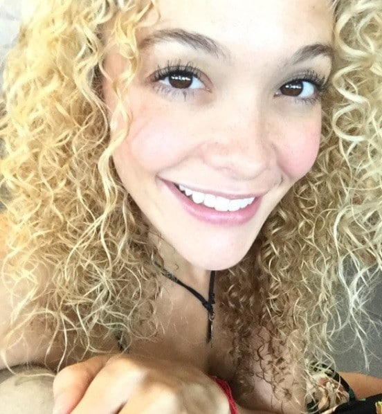 selfie of a woman with butter blonde curly hair