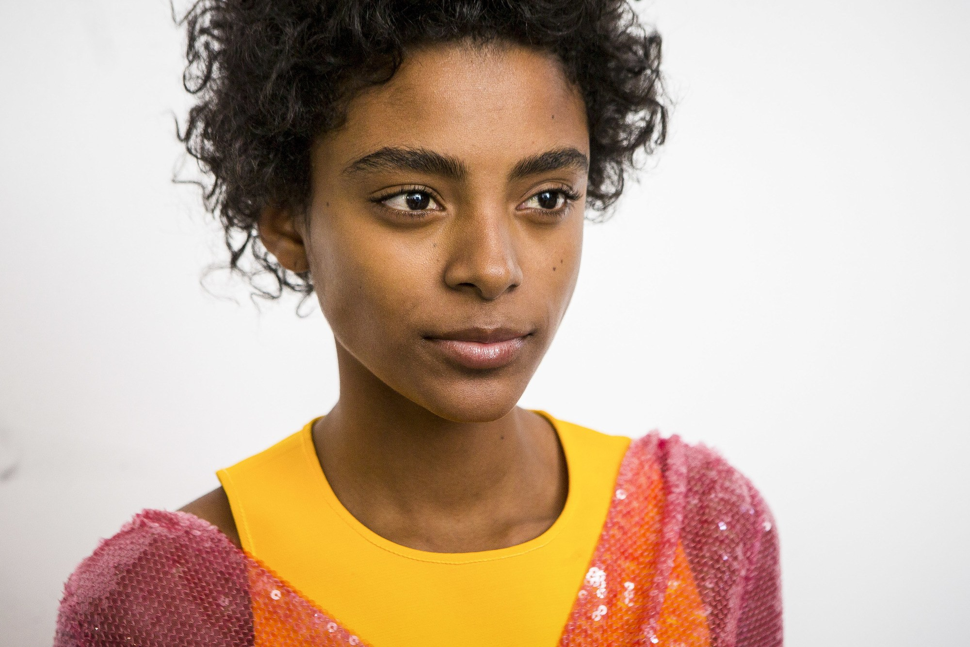 co wash shampoo: model with curly hair backstage at show