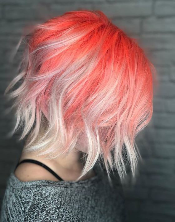 Short ombre hair: Woman with short wavy bob with coral roots and silver ennds ombre colour.