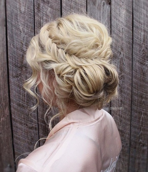 Curly prom hairstyles: Blonde girl with her hair in a curly fishtail braided prom updo