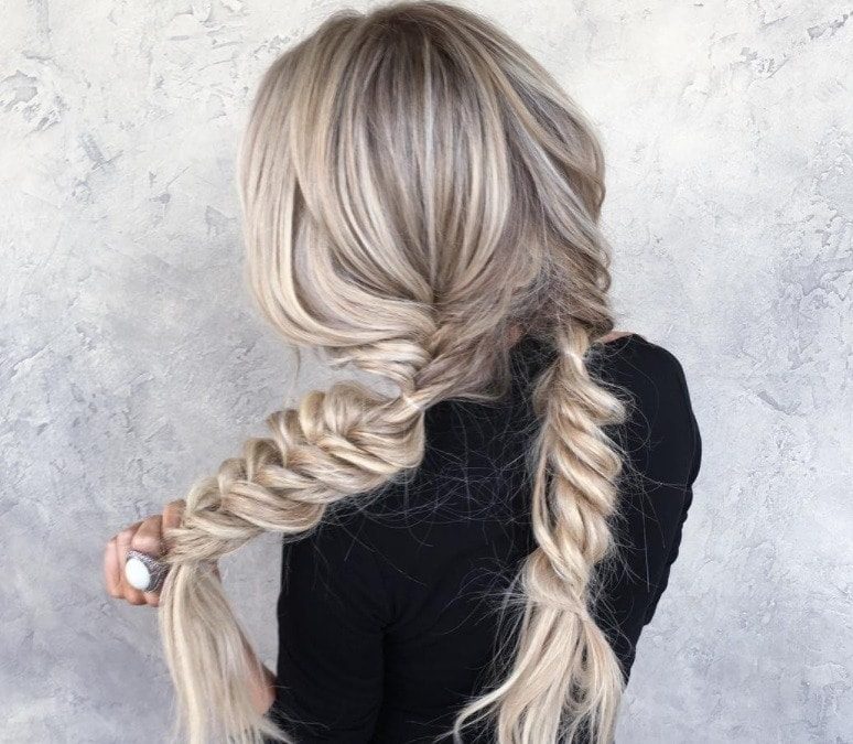 hairstyles for greasy hair: woman with fishtail braids
