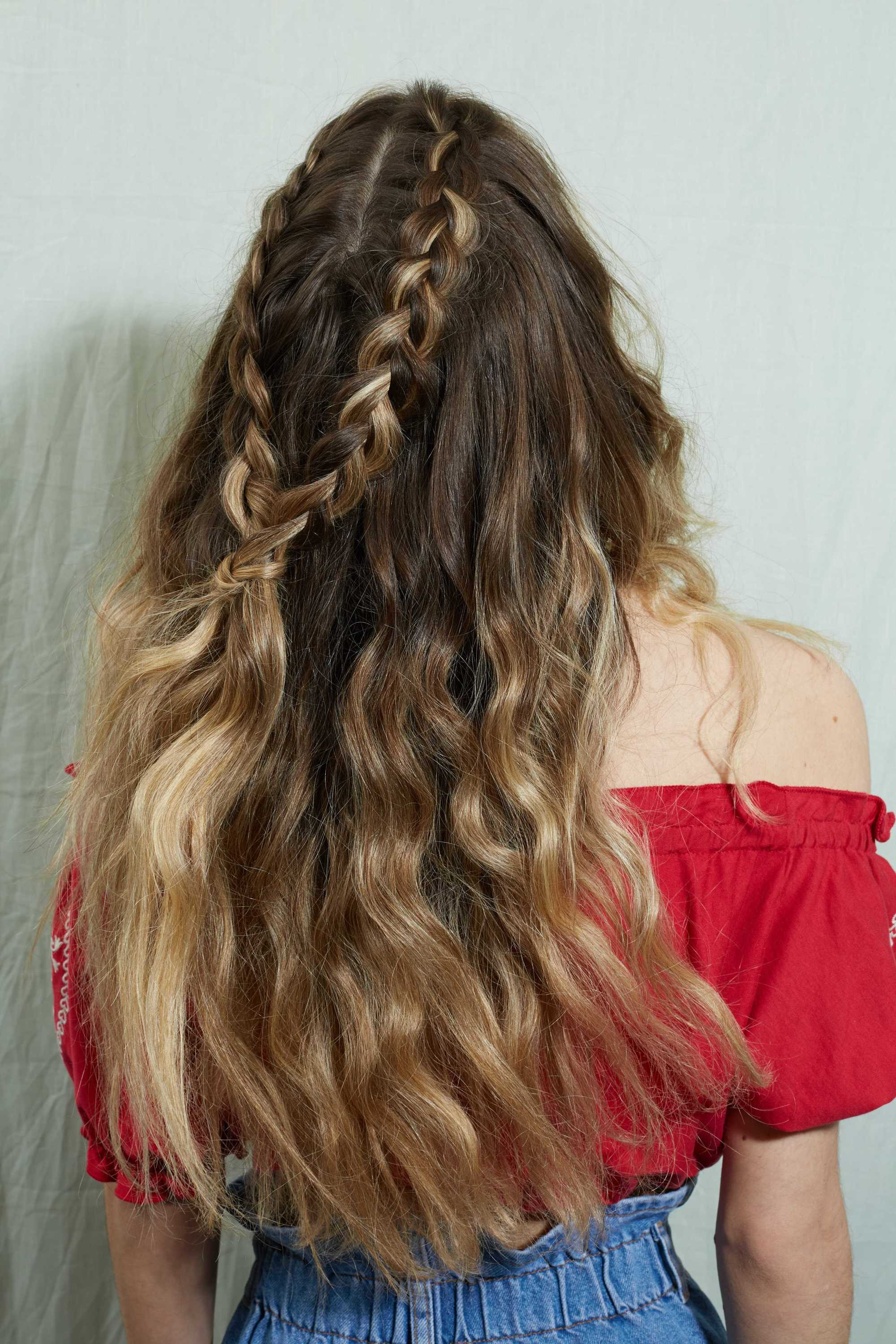 Woman with wavy brunette ombre hair in a half-up braid