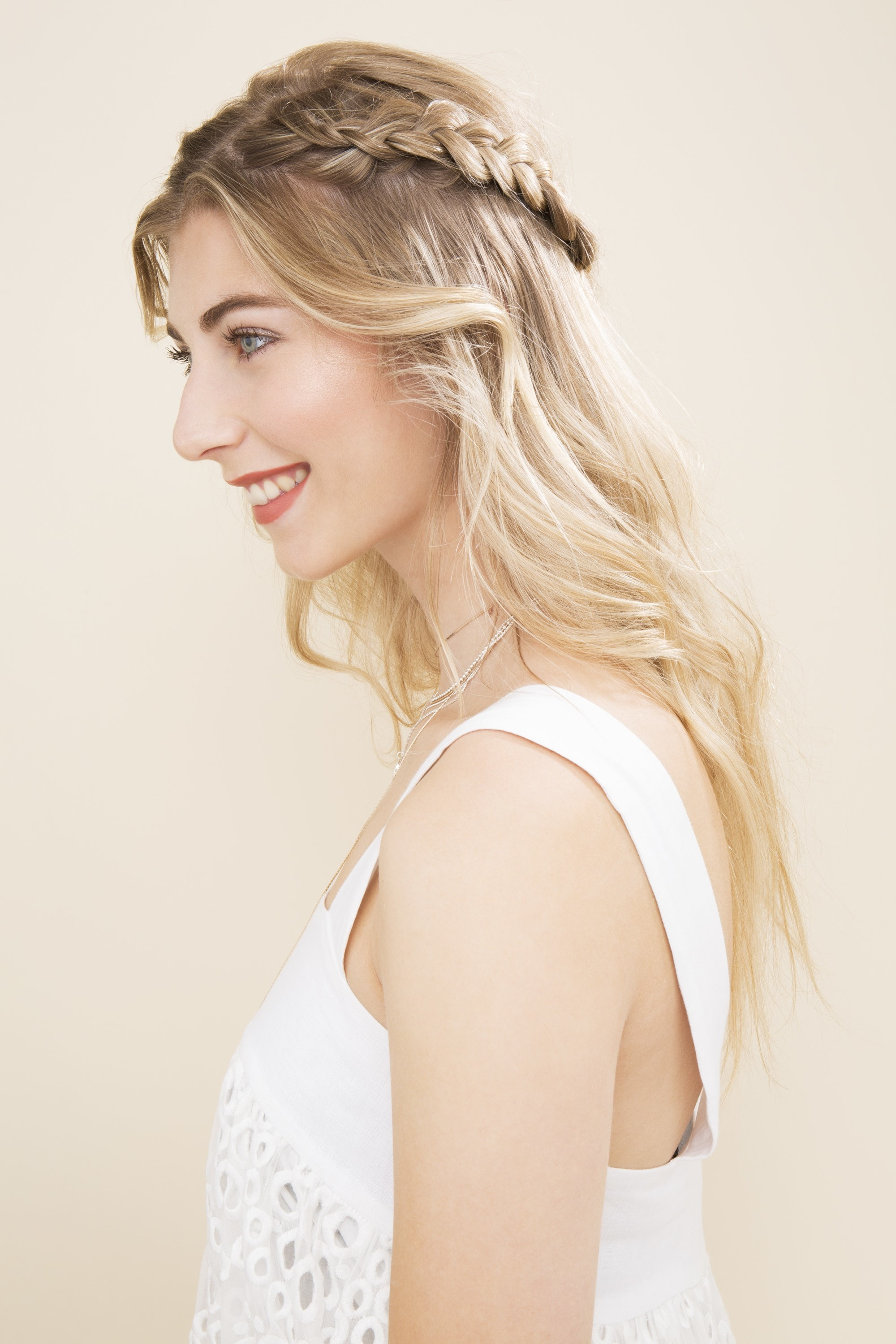 Boho hairstyles: Blonde with hair in a half-up crown braid with loose wavy ends